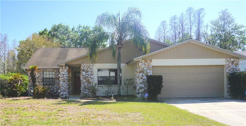Spacious 4 bedroom waterfront home on oversized lot offering lakefront and conservation views ! Popular open split plan, and oversized family room with elegant wood floors which add a touch of warmth and comfort. This home has many added features that you must see to appreciate, including but not limited to elegant tile flooring, wet bar in living room, spacious screened in porch overlooking beautiful fishing lake and conservation and much more! Community offers Tennis, Racquetball and lighted basketball courts as well as 1/4 mile track. In addition there is a club house complete with full service lounge and pool tables as well as banquet room with fireplace. In addition there is an olympic sized pool great for those hot summer days! Must see to appreciate everything this home and community have to offer!! Hurry will not last!!