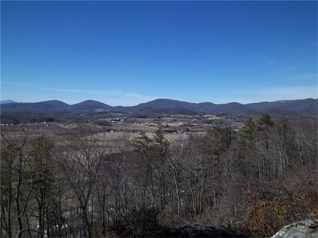 3.6 amazing acres. Property sits about 100' off Gilliam Mountain Rd with paved access.  A special piece of property with S-SE Exposure and winter views easily turned into beautiful year round views. Almost level easily accessible homesites. Huge boulders and rock outcroppings on the property making the back yard a rugged NC Mtn playground. Homesites would be almost zero maintenance. Gilliam Mtn Rd is a state maintained road. It is a short 20 min drive to HVL and 10 mins to convenience stores,  20 minutes to Bat Cave/Lake Lure area.  A pathway has been cut into the homesites and brush has been cut on the homesites for easy access.  If you are going to check it out park in the short driveway by the For Sale sign and the Brochure Box.  Be sure to wear hiking boots if you plan on exploring any of the boulders or rock outcroppings. If you do, please do so at your own risk. The listing agent is available to show the property with short notice. Manufactured homes and modulars are approved.