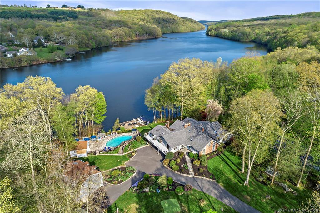 This spectacular Lake Lillinonah Villa on 2.24 private acres is truly one of a kind.The gated property includes: 7,000 sq ft Contemporary, 1,440 sq ft Guest House, 360 sq ft Pool House, Gunite pool, tennis courts, patio, wrap around deck, gazebo, lakefront deck, & private dock.The light filled Main House features a dramatic open floor plan; a Great Room w/hdwd flrs, a 2-story whitewashed brick fireplace, cathedral ceiling, wall of windows & sliders to deck.Expansive Kitchen has beautiful cabinetry, granite counters, tile backsplash & flr, an L shaped island w/6-burner propane range & copper hood, prep sink, & wine cooler.Sub-zero refrig, 2 wall ovens, pizza brick oven. The eat-in area overlooks the lake & has vaulted ceiling & skylights.A formal Dining Room w/hdwd flrs & French doors to the deck. Highlights of the sumptuous Master Suite: Sitting Rm w/built-ins & sliders to deck, solarium, full BA w/Jacuzzi & dressing rm. 2 addtl BR & Full BA complete main level. Walk out LL has FR w/fireplace,built-ins, & slider to patio. Guest Suite w/sitting rm, & full BA. Office, Laundry, Storage. Chic and spacious Guest Hse has Great Rm w/dining area, vaulted ceiling, skylights, KT w/breakfast bar, sliders to deck. BR, 2 BA, LL Bonus Rm w/ceiling fan, & spiral staircase. Set on Lake Lillinonah, the private grounds offer limitless opportunities for recreation & relaxation from every angle.