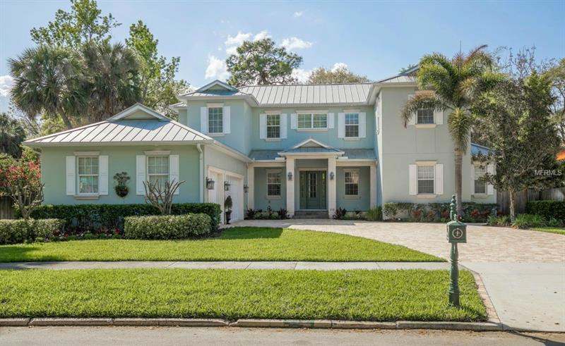 This beautiful and meticulously maintained Beach Park home has it all, with 5 large bedrooms, 3.5 baths, GOURMET kitchen, THREE car garage, plenty of outdoor space and all situated on an oversized 11,000 + SF corner lot.  You will truly appreciate the care and condition the owners have taken in maintaining this impressive home the moment you step through the large solid wood doors onto the beautiful OAK FLOORING with decorative inlay.  Feel the open concept design of the great room with its large picture windows and glass French doors, high ceilings with decorative crown molding, and gas fireplace enhanced by the custom built-in cabinetry. The gourmet kitchen will impress with beautiful GRANITE countertops, custom antiqued cabinets, oversized farmhouse sink, stone backsplash, STAINLESS steel appliances with gas range, large island with prep sink, breakfast bar and additional space for informal dining. The downstairs master suite will continue to impress with its spacious size and direct access to the outdoor lanai. The in-suite master bath possess dual granite vanities, large jetted SOAKING tub, separate rain shower with tumbled stone, smooth Travertine flooring as well as two large walk-in closets. The second floor contains FOUR full sized guest bedrooms with one serving as a professional OFFICE with custom built-ins. The backyard has a large covered lanai with slate flooring that provides excellent space for entertaining, WATERFALL SPA, lush tropical landscape, and PLENTY of room for a pool.