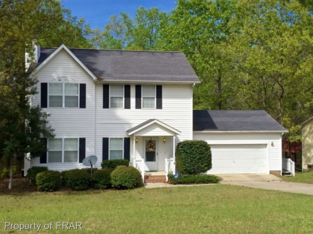 3 bedrooms, 2.5 bathrooms, two story with large living room, large open kitchen with bar, large dining area, back deck, patio, golf front, close to exit gate of Gated/guarded Community. Enjoy all the amenities of Carolina Lakes