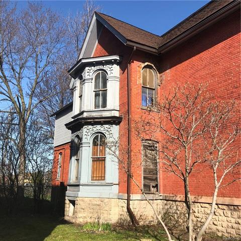 This beautiful Victorian / Italianate house features a first floor slate fireplace, ten foot ceilings, a curved staircase with carvings, ornate woodwork, six scones in living room, double entry doors and tall windows. The windows on the outside are covered with intricate metal / carvings. The bays are large and light streams thru the windows. The home is situated on a large lot. This is located in a prime spot and within close proximity to downtown Detroit, Corktown and the Woodbridge Historical area. What a gem!Italianate