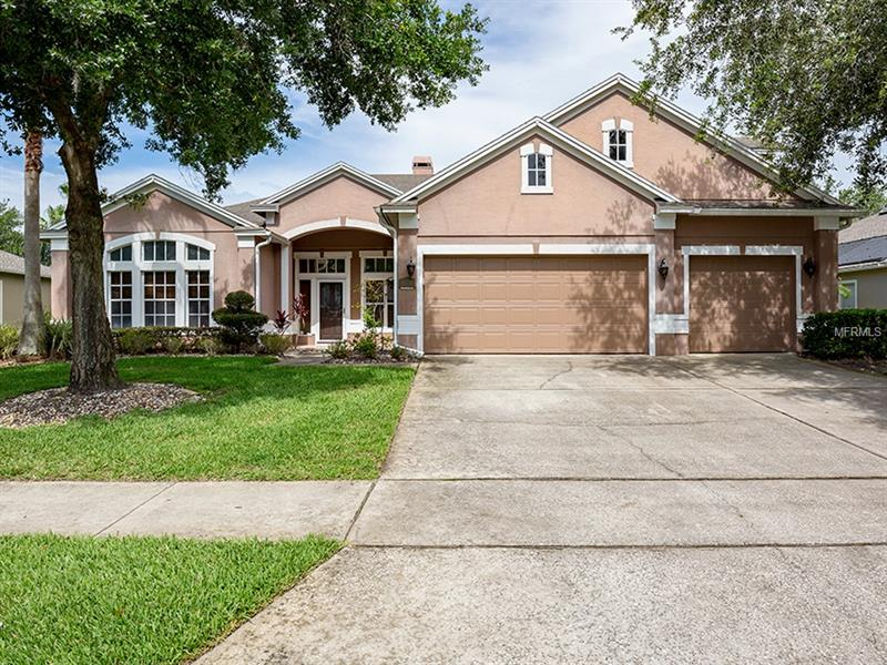 $7k PRICE DROP!! Prepare to fall in love with this Renovated Executive Style Pool Home located in Timacuan, one of Lake Mary's premier country club communities. This immaculate 4br/4ba + Bonus Game Room/5th Bedroom home sits on .24 acres and is Zoned for Seminole County Schools. As you walk through the front door you are greeted by a bright open floor plan with volume ceilings, 3/4 inch wood floors and marble tile throughout. The gourmet kitchen boasts of top of the line granite counter tops, solid wood double stacked cabinets , stone back splash, stainless steel appliances, an island with deep storage and a sizable eat-in dining area with access to the screened-in pool. The spacious family room has a wood burning fireplace with built-in shelving and French doors that lead out to the pool. The secluded master bedroom features a gigantic walk-in closet with custom shelving. The remolded master bathroom has travertine flooring, a seamless walk-in shower enclosure and a soaking tub. The guest bedrooms and bonus game room/5th bedroom have all have been tastefully painted and updated with wood floors. The pool area includes a covered lanai with a separate exterior access pool bathroom, solar panel pool heater, brick pavers, resurfaced pebble tech surface and water feature. The remainder of the home has an interior laundry room and 3 car garage. Just minutes to I-4, 417 expressway, Lake Mary/ Heathrow's Town Park, Seminole Town Center and Shopping.