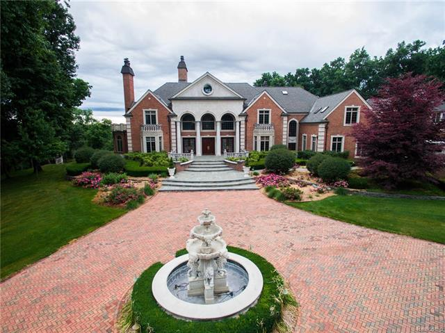 VERY MOTIVATED SELLER!!!!! Castello Montebello, a palatial estate, sits on three pristine acres near the historic district of Northville, the most unique property in Michigan. This property has hosted several US presidents and foreign dignitaries. Over 17,000 sq ft of sheer elegance, this home is a former diplomatic estate ,was once the consulate of the Czech Republic. It offers the most discerning buyer complete privacy, security and luxurious lifestyle. Guard house, bank vaults, wine cellar, mother-in-law suite, theatre is a replica of the most famous theatre in NYC, The Paramount Movie Palace. Incredible one of a kind craftsmanship throughout. Three additional one acre lots also available for purchase, see lots B, C, D addt pics available upon request. Seller requests pre approval; seller financing is available.