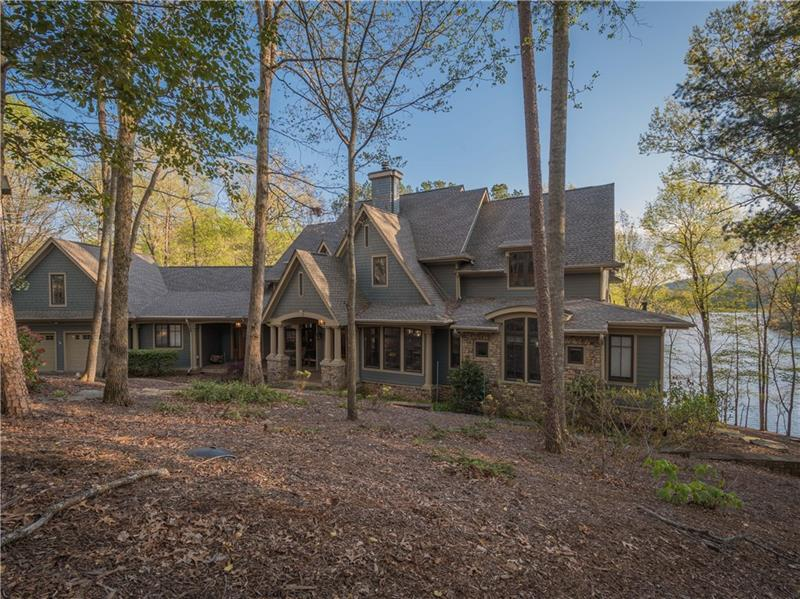 "This amazing Lakefront home which offers panoramic views of Lake Petit and the mountains is an architectural masterpiece featuring unique details and natural elements that are reflective of its mountain environment. Walls of windows looking to the view and extensive outdoor spaces provide areas for entertaining or simply enjoying the natural beauty of the Blue Ridge Mountains. A floor to ceilling stone fireplace graces the coffered great room while dinner guests enjoy the view from the spacious curved dining room. This home is a ""must see"" for the discriminating buyer."