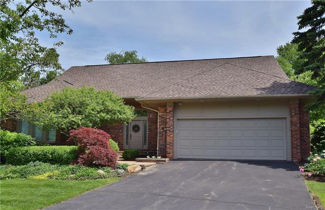 Bright & light-filled condo in highly desirable Quarton Orchards location. Impressive 2-story marble foyer welcomes you into the formal living room with floor-to-ceiling windows & vaulted ceiling and flows to elegant dining room. Well-appointed granite kitchen with stainless appliances opens to breakfast nook with access to deck through large sliding glass doors.  1st floor master suite boasts his/her walk-in closets & generous sized bath with dual sinks and has direct access to sophisticated library with fireplace & beautiful built-ins. Winding staircase leads to upper level with 2 additional ensuite bedrooms. Large finished basement with plenty of space for entertaining and tons of storage.  Large 1st floor laundry. 2 car attached garage. Small exclusive development close to shopping, dining and Downtown Birmingham.