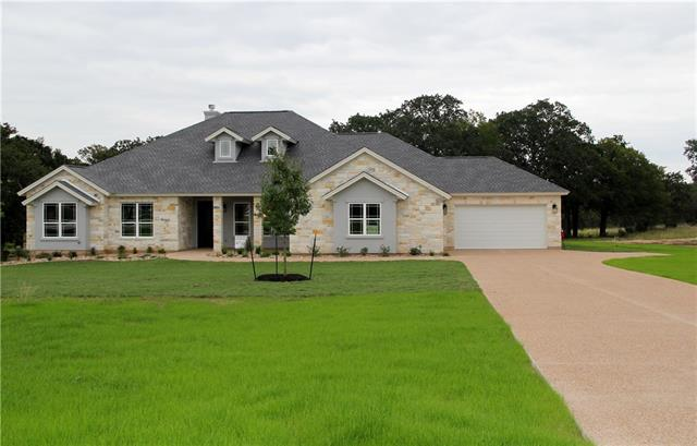 Beautiful custom built home on over 2 acres with hill country views 4 bedroom 3 full baths and a large 4 car garage. Huge covered patio over looks a private tree covered yard with room for a pool and anything else you can imagine. All custom cabinets and designer colors bright and open floor plan. Come by and take a look. Ask about our end of summer incentives!!