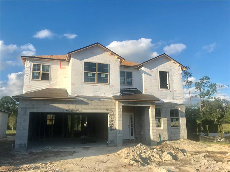 """Under construction- Move-in this year! Located on a private cul-de-sac homesite, in a boutique community of just 30 homes, 4711 Oregon Acres Cove is located just minutes to I-4 and 417, and the John's River boat launch.  A gourmet kitchen with 42"""" cabinets, silestone countertops, and a farmhouse sink overlooks the dining area and the family room, creating the perfect entertainment space. Complimenting the indoor entertainment space is a trussed 12'x10' outdoor lanai. Low-maintenance wood grain floor tile covers the entire main living area. A private guest room and full bathroom complete the first floor.  Upstairs are the master suite as well as two secondary bedrooms, all with walk-in closets, and a spacious laundry room.  A loft area was designed to be the perfect space for movie night or homework time."""