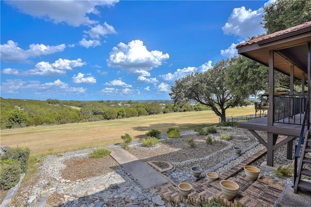Buyer had a change of heart inspection was not done. The stunning panoramic view from this elegant Lake Travis getaway will exhilarate you the moment you walk in. Single-story, all-brick, 2/2/2 golf course home is located just six blocks away from the deepest boat ramp on Travis, so bring your lake toys! Immaculate move-in ready home features an open floor plan, spacious bedrooms, hardwood floors, granite and stainless kitchen, Energy Star appliances, concrete tile roof, and low-maintenance xeriscaping.