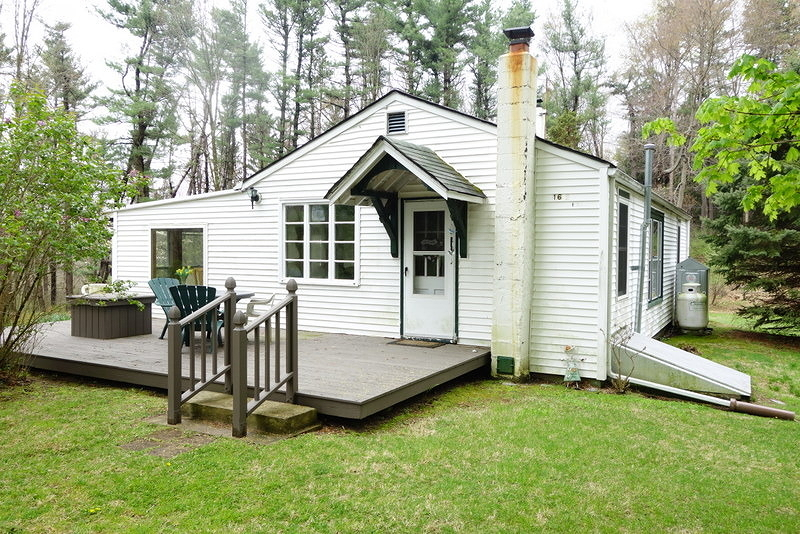 Owner will install new septic prior to closing. Secluded Paradise on 4.4 acres. Very Private..Surrounded by Woods...Owner has used this home as a Weekend Retreat for many years. Great Sunroom/Family Room with views of Nature and Woods
