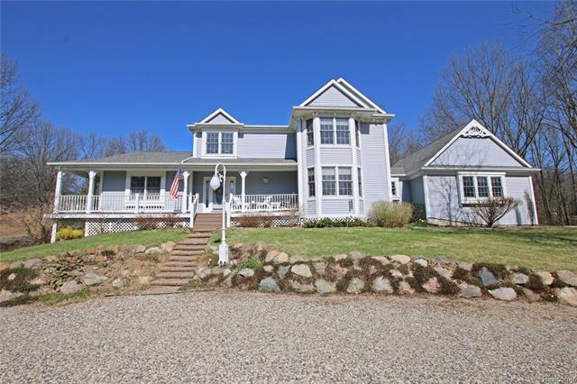 Custom Design by Jeff Harrell...Original owners have taken fabulous care of this stunning home.  Large windows throughout.  Jack and Jill bath, Main floor master suite, 2 furnaces, large mud room, oversized laundry w/sink, maintenance fee deck.  Finished walkout lower level with bedroom and bath.  Wrap around porch.  Auto emergency house generator.  If you are looking for a peacefull private setting this is you home!  Natural gas at road.  Assocoation fee is for road maintenance.