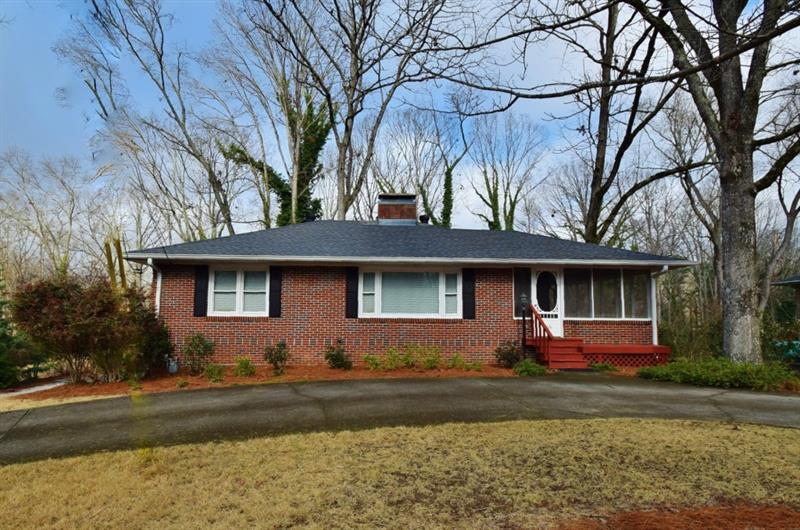Great 4 side brick home in great in town location. Super well built 50's home with updated bath and kitchen. Enjoy coffee on the screend porch and listen to the birds from the woods in the back. This won't last long! Walk to parks.