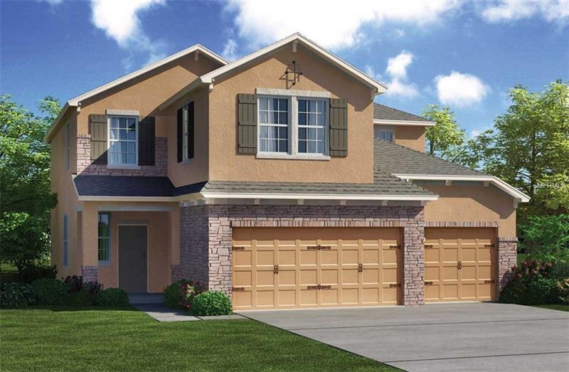 Tuscan Exterior with 3-car garage and stone accents