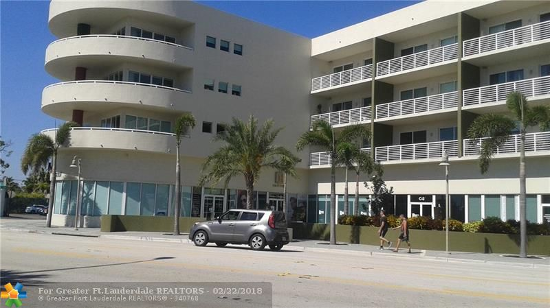 MOST CENTRALLY LOCATED MIXED USE BLDG ON THE DR. WALKING DISTANCE TO ALL THAT WILTON MANORS HAS TO OFFER. GLASS WALL FROM FLOOR TO CEILING, GREAT FLOOR PLAN FOR ENTERTAINING.  ONLY FLOOR PLAN WITH 3 BALCONIES. SPLIT BDRMS, MARBLE IN MB, 10FT HIGH CEILINGS, SS APP, GRANITE, XXXTRA STORAGE IN MEZZ LEVEL, W/D IN UNIT, 2 ASSIGNED/COVERED PARKING SPACES ON GROUND GARAGE. PET FRIENDLY.  FULLY EQUIPPED FITNESS ROOM, BBQ AREA, SWIMMING POOL.  EXCELLENT LOCATION WHERE YOU CAN LIVE, WORK AND PLAY.
