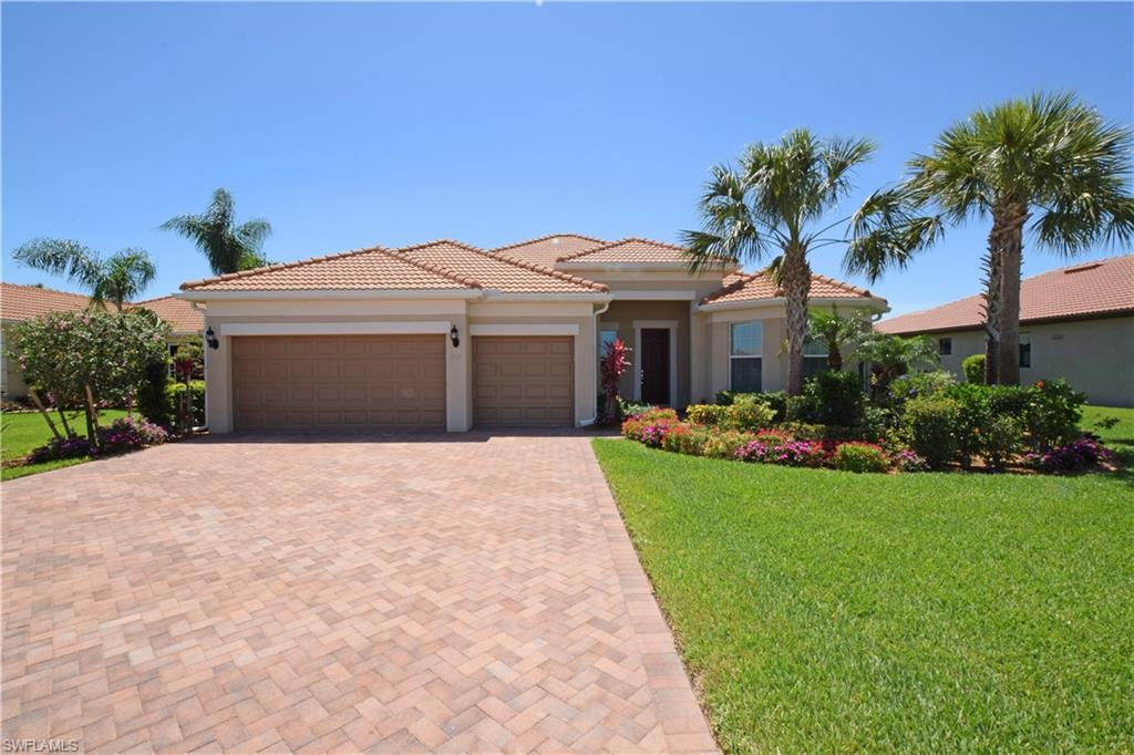 This immaculate, bright estate home with the much preferred open main living area is located on an over-sized premium water lot on quiet cul-de-sac in popular Italian-themed section in Del Webb-Naples, high-lighted by series of old-world-charm bridges over Bellera's many canals.   The home has today's most wanted features: kitchen with large island & tall cabinets, office with wall of custom-built cabinetry & granite counter-top, crown molding & upgraded tile flooring throughout, high-end appliances, upgraded lighting & ceiling fans, laundry room storage, security closet, and impact windows & doors for storm protection.  The backyard has custom salt water heated pool with extended lanai with lush landscaping. Colorful plantings have been added to accent curb appeal in the front and sides of the home.  Residents have access to the 18-hole championship Panther Run Golf Course, Oasis Clubhouse with lagoon pool & spa, lighted tennis, bocce & pickle ball courts, bar & grille, outdoor amphitheater, scenic walking & biking trails, and many activities promoted by onsite lifestyle director.  Town center has a Publix, restaurants, gas station, and a variety of shops.
