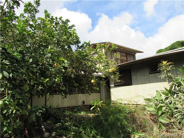 Great Level 2 Acre Lot with old Fixer Upper. Many mature Fruit Trees... great location for Farm Stand on Farrington Hwy. frontage. Country Living at its best ... you'll just need to do some fixing up to live there!