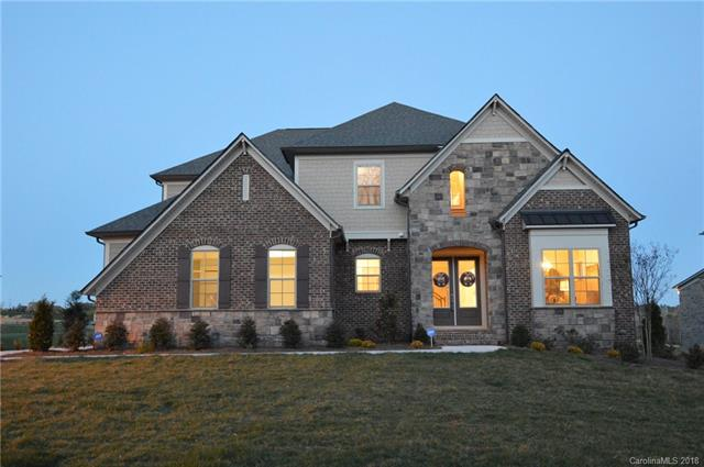 A large, elegant 7 BR Home with Tons of Upgrades!! Extra Large Basement with tremendous storage areas!! Extra Living Room Loft Area Upstairs! Mud Room and Butlers Pantry!,  3 Car Garage!  Blinds, $5000 in added Lighting, Added extra BR and Exercise Room,  Modern Kitchen with extra large Island Bar with extra cabinets and farm sink, Crown Molding throughout downstairs,  Upgraded paint and flooring, ceiling fans, Coffered Ceiling in family room,  surround sound in Loft, Tray Ceiling in Master Bedroom, Upgraded Master Bath with Rain Shower, Stone Fireplace, Irrigation System, 2 Large Storage Areas, 2 water heaters.  Awesome Neighborhood Amenities including pool, clubhouse, pond, playground, tennis courts and sidewalks!  A Great Family Home!!  The downstairs bedrooms do not have windows but it still considered a bedroom per MLS.   Also,  the 7th bedroom can use the large storage room beside it for a closet.  It can also be considered an exercise room.