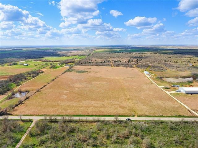 Ready for your dream home! Grab this beautiful Ag exempt wooded acreage with wide open pasture in the front, perimeter fenced on 3 sides. So many possibilities, grab it before it's gone!  This is 2 parcels being sold together, includes property IDs 187442 (9.321 acres, Lee County) & R539827 (18.246 acres) for a total of 27.567 acres.