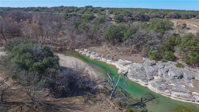 Searching for large acreage, nice home, stunning Views, exceptional swimming holes and great hunting? Look no further, we found it and it's only 45 minutes from north Austin.  Numerous oak covered hilltops overlooking the peaceful creek bottom below and several other valleys filled with an assortment of hardwoods. This ranch has one of the nicest swimming holes you will find on highly sought after Rocky Creek. It's the perfect setting for family adventure, swimming, fishing, or floating.