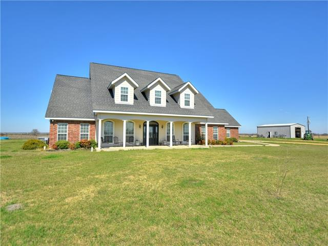 Beautiful ranch property in the acclaimed Thorndale school district!  Immaculate custom home sits on a high elevation offering great panoramic views.  The home features 4 bedrooms, 3 baths, game room, exercise room, formal dining, and sunroom.  The unrestricted property is currently used for ag production with hay, corn, and grazing for cows (all leased out for ease of owner).  There is also a nice metal barn/workshop.  There is an additional 89 acres across FM 486 with river frontage available as well.