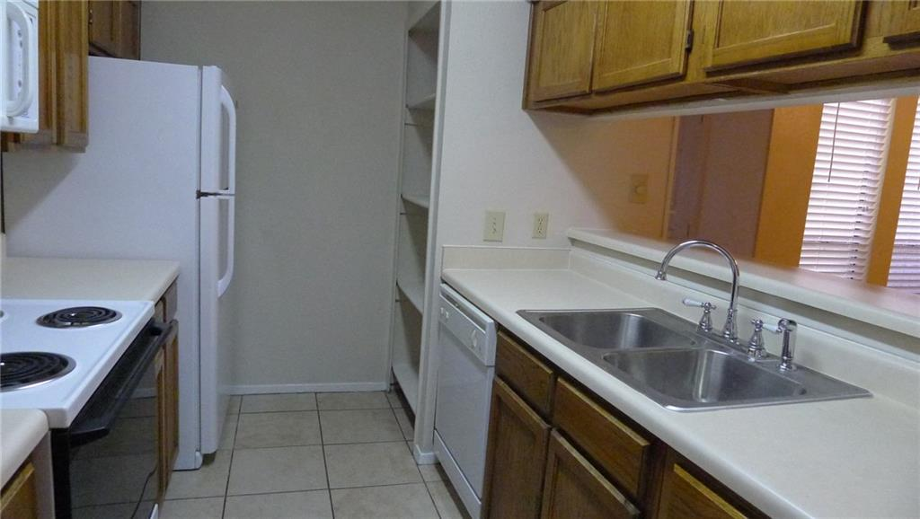 Nicely updated 2 bedroom, 2.5 bath townhome-styled condo in gated community across from Hong Kong Supermarket. 2 master suites upstairs. Tile floor downstairs and in bathrooms. Clean carpet. Recent paint. Fridge. Microwave. Washer Dryer. Ceiling fans. Balcony. 2 covered parking. Convenient to shopping, highways, schools. Walk to Richland College.