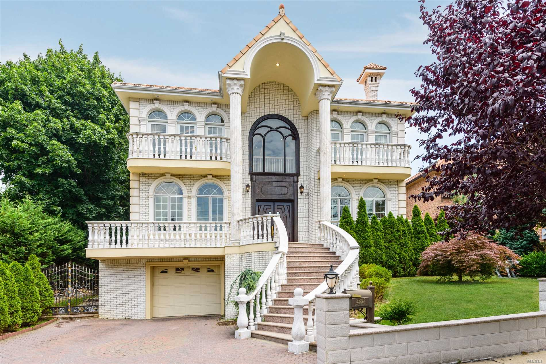 Spectacular Custom Built Colonial W/ I-Beam Structure And Luxurious Marble Exterior. This Home Features Over 10,000 Sq Ft Of Living Space, Built By The Builder For His Family. Gourmet Eik W/Custom Pocket Doors. 2 Over Sized Master Suites W/ Balconies. 3 Br's W/ En Suite Full Bath's & Balconies. Rare 12' Ceiling Basement With Den/Gym/Spa Bath & Much More! Situated In The Heart Of Little Neck Hills!