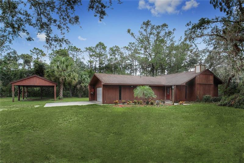**Live in sought after Oviedo with desirable Seminole County Schools.** Prime country living yet just minutes from everything.  Situated on a little over an acre- plant a garden, store your boats, RVs and more.  There's no HOA and abundant space for all of your needs.  Tranquil setting and mature trees make this peaceful paradise just minutes from local shopping, restaurants and easy access to anywhere in Central Florida.  **Updates abound-NEW SEPTIC TANK, PUMP AND DRAIN FIELD (2017),  NEW LANDSCAPING AND SOD (2017), NEWER ROOF AND REBUILT CHIMNEY, NEWER APPLIANCES, NEWER GARAGE DOOR, AND OPENER, REBUILT BACK LANAI AND NEWER SLIDING GLASS DOORS. ** The living area boasts a rustic wood burning fireplace and easy care tile floors.  2 car garage plus a large carport area and open area add to the appeal. Conveniently located with easy access to 417 & 408, Shopping, Dining & UCF. Don't miss your chance to live in this quiet community convenient to everything!