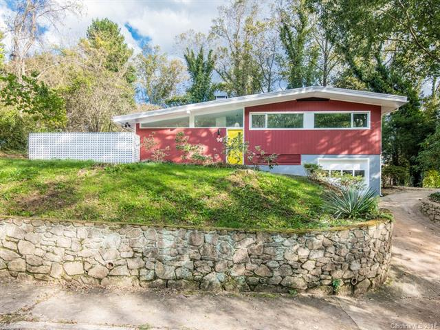 Own a pitch perfect mid-century creation by renowned artist/builder Randy Shull.  Wonderfully designed open floor plan with wood-burning fireplace in great room and state of the art kitchen, all opening to huge private, walled terrace with another large fireplace. Beautifully coherent sense of indoor/outdoor spaces, sun-drenched rooms and perfectly placed windows.  Handcrafted custom cabinetry in almost every room. Extra large, private lot and plenty of off-street parking. Don't miss this rare opportunity to own a completely renovated, mid-century home in popular West Asheville...and walkable to Haywood Rd shopping and restaurants!