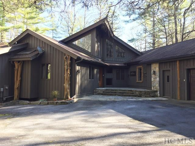 Great rustic charm on Lake Toxaway with a gentle walk to the lake, private dock, 3 bed 3 full baths and 2 half baths, Large covered and uncovered decks, Perfect for large families.  Great rental history.