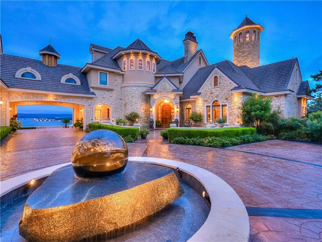 Welcome to an extraordinary Lake Travis Waterfront Estate. Enjoy world class, gated compound on a private 13+ acre peninsula surrounded by exquisite views of the lake visible from most rooms.Covered terraces, huge garage, separate guest house with all amenities. Enjoy 50 foot turret with phenomenal views. Architectural detailing, ultra-luxurious and elegant finishes, commanding landscaping including global monuments, stunning infinity pool and custom boat dock make this property truly one-of-a-kind.