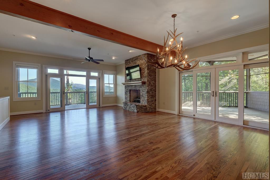 This is the most sought after floor lan in The View with no steps going in! The main floor includes a living room with fireplace, master suite and guest bedroom (each with its own private bath), dining room, spacious kitchen, screened porch with fireplace, and an additional covered porch with an exceptional mountain view.  Downstairs offers another living room and porch, and a second master suite.