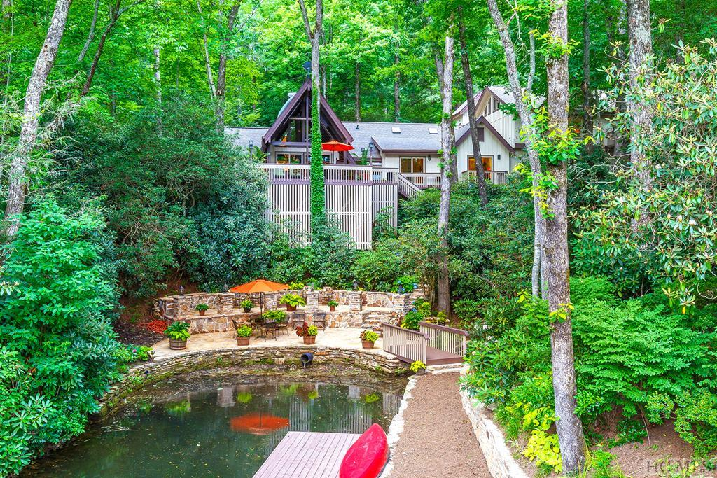 "Absolutely meticulous custom lakefront home on a private very special cove of Lake Toxaway.  With a backyard likened to a ""mountain paradise"", this comfortable home features two kitchens, extensive area for entertaining, hardwood floors, granite counter tops, vaulted ceilings and beautiful fireplace.  Magnificent outdoor stone patio adjoining the lake, boathouse with exceptional large sundeck, flowing stream and separate pool house make this home an exceptional find and a must see."