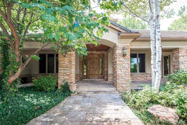 Welcome to this lovely family home on over half a peaceful acre in The Preserve.  Located in the coveted Cherry Creek school district, this property backs to the lush 45-acre Marjorie Perry Nature Preserve and the Highline Canal walking path.  The discrete, wooded front exterior opens to three full levels inside, including a spacious main floor master bedroom suite.  The floor plan allows for everyone to have private spaces, with two bedrooms on each level.  His and her studies on main floor.  Lowest level is fabulous with family room opening to patio and outdoor firepit, 1000 bottle wine room and must-see exercise area with free throw basketball lane and climbing wall.  Sound system stays with the house!  Professionally landscaped grounds and gardens.  Multiple decks and patios for easy outdoor entertaining.  Plenty of room in the four car attached garage.