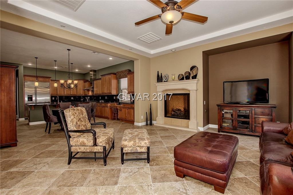 Fantastic home, stunning luxury! Privately tucked in highly desired Madeira Canyon community, This immaculate single story home features high ceilings and luxurious upgrades throughout including, gorgeous gourmet kitchen one of a kind granite countertops & cabinets, high-end appliances and much more.  This 3 bedroom 3 Bath home has an open floor plan with large bedrooms and den. Master includes walk-in closet & spa like bath w/jetted garden tub.
