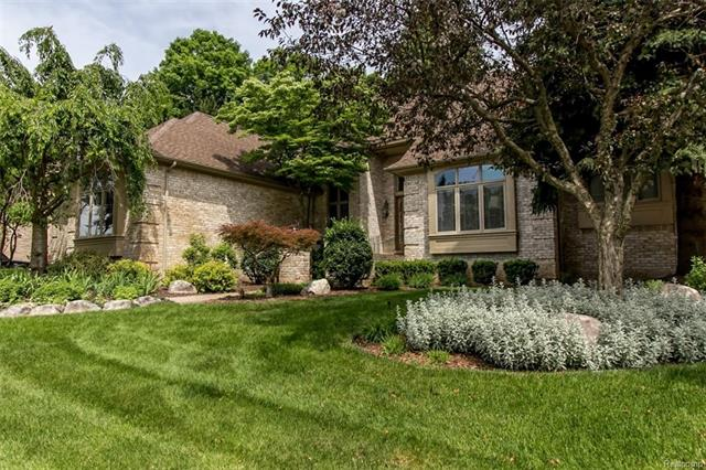 Prestigious Oxford Estates-One of a kind. Custom ALL Brick Colonial with over 5600 sq ft of living space (blt by Walter Pytiak Fine Homes & Estates-builder). 4 Bedrooms, 4.1 Baths, 3 PLUS ATT GAR (37WX24DX13H). Huge deck on rear of home backs up to heavily wooded area. 2 Story open to ceiling in Great Room, architectural accents, full ceiling to floor windows in many rooms. Beautiful crown moldings, 2 gas fireplaces; 1 in Great Room, 1 in fully finished basement (2000 sq ft) with full kitchen and bath. 1st Floor Master Bedroom w/ tray ceiling and double door entry & Large Walk-in Closet. French doors to Library. Roof (2014), 2 GFA's. CA's (2009). Sump pump w/ gas back-up. Exterior Paver Walkways & stone berm at end of driveway. Schools: Hillside Elem, East Middle & North Farmington High.