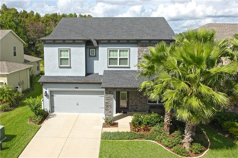 "Move-in-ready & Picture Perfect! Located in the peaceful gated Village of Bellafield in the desirable award winning community of Seven Oaks. This like new 5bed/4ba + office + Bonus, features an open concept floor plan, located on a conservation lot. The bright open kitchen is a chef's dream, boasting a huge center island, breakfast bar, granite countertops, SS appliances, rich 42""cabinetry, tile backsplash & walk-in pantry. Bright & cheerful casual dining that enjoy stunning views of the backyard! The kitchen opens to the great room & to the dining room making it ideal for entertaining. Enjoy Florida living at its best on a covered lanai with spectacular views of the conservation backyard. Details includes ceramic tile, abundant windows along the back of the house, which fills the home with bright natural light. The large backyard is a perfect place to enjoy the beautiful Florida weather & lifestyle! The spacious master retreat offers a sitting room & features a gorgeous coffered ceiling, huge walk-in closets & a spa like bath boasting, quartz countertops, & his and hers vanities & large walk-in shower. This home is picture perfect & shows pride of ownership. Basketball court & playground nearby. Close to Highly ranked schools, Wiregrass Mall, Florida Hospital, State College, ICE Complex, dining  Premier Outlet Mall, with easy access to I-75 & 275. Seven Oaks offers a resort like clubhouse, Olympic pool, family pool, spa, Movie Theater, slide, gym, playgrounds, walking trails & tennis. Taxes includes CDD."