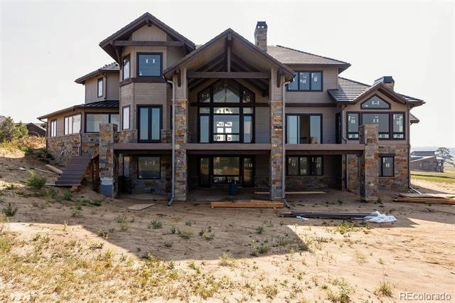 Surround your next home in luxury and comfort and the most amazing views of the front range in a quiet setting you could ever find. This NEW CUSTOM home will be available November 2018.  8475 Lost Reserve Court is a home that feels like a resort retreat beyond the finishes of other homes in the area.  This is a suburban golf course gated community with amazing amenities for golf, swimming, hiking and the most gorgeous views of the Colorado Front range.  Memories are made in homes such as this with excellent entertainment areas both formal and casual events, family gatherings, and two amazing outdoor decks and patios to really soak in the Colorado weather and lifestyle.  This majestic home offers it all and sits on the 15th Fairway of the Championship Golf Course at Colorado Golf Club.  Only one of seven lots that are adjacent to the course, which sits within a conservation easement.  ASK US ABOUT THE CARRIAGE HOUSE OPTION TO INCREASE GARAGE CAPACITY AND ADDITIONAL LIVING QUARTERS.