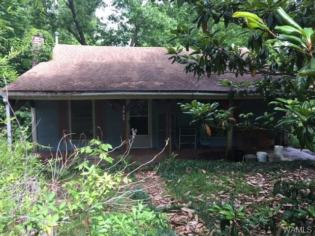 This property is in the county (per owner) city on both sides of it,. Has a recent roof and HVAC but no date . Years of cosmeticals needed and some eave damage on back right eave and front corner and chimney. Is connected to well water and needs connected to city water- estimate is $1800. Estate sale- AS IS