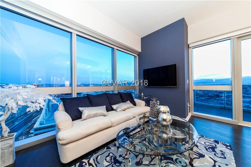 This exceptional gem on the 42nd floor provides a unique use of the space and stunning views of the Las Vegas Strip. A rare corner unit with a an extended terrace, this unit has been upgraded with an electronic divider that creates an additional enclosed space. The community offers a spectacular array of amenities which include a resort style pool & spa, massage and steam rooms, world class fitness center, and even complimentary limo services!