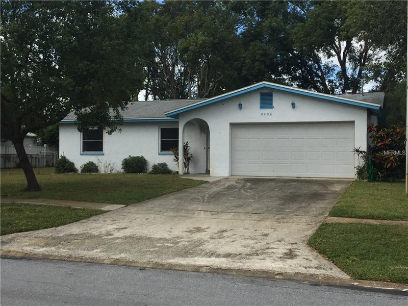 Affordable and in Seminole, this home, is on a quiet residential street, on a large corner lot.  3 bedrooms 2 bath block house with a 2 car garage, sits on a lot 85 x 112 and is move in ready.  The property has an open floor plan and newer windows and a newer AC (2016).  Master bedroom has an on-suite bathroom with a walk-in shower and the second bath has the tub.  Washer and dryer are in the garage.  Kitchen opens up to the dining area and living area (great room type).  Backyard is fenced for your pets.  The kitchen has a nice newer window above the sink, making the kitchen light and bright.  Minutes from the new Seminole city center, the Seminole schools, the post office and the Seminole library.  A short drive to Madeira Beach or Indian Rocks.