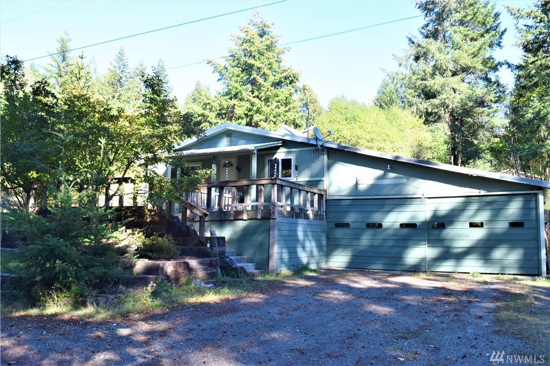 Nice Packwood home with potential. Great location close to Packwood amenities. Approximately 20 minutes to Mt Rainier Stevens Canyon entrance and White Pass Ski Area. This home is 3 bedroom/2 bath + office. Features a very large kitchen and open living space. Pellet stove, 2 car garage, with lots of storage. Fruit trees and garden space.