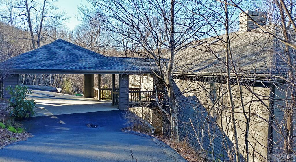 This contemporary home has high window walls overlooking a huge view of the Blue Ridge mountains. There are 2 bedrooms on each level with the master on a private wing overlooking the long range unobstructed view. The great room features a stone fireplace and built-ins and a deck. The spacious dining area enjoys expansive views and a deck for relaxing and dining outside. The split bedroom plan on both levels affords privacy and accommodates lots of family and guests. The family room below has a pool table, a spectacular view and features a large deck as well. This is a low maintenance property with no lawn. The porte cochere and circular driveway offer plenty of parking. This cheery home is being offered furnished.