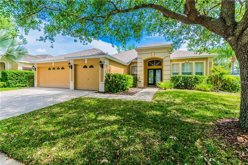 """Popular open floor plan offers 2,355 sq ft, 4 bedrooms, 3 baths, 3 car garage, with fenced lot in the guard/gated community of Arbor Greene in New Tampa. Many NEWER including roof (12/2015), exterior paint (2013), hot water heater (2012), Stainless appliances (2010), A/C (2009). Large Family Room open to the Kitchen with sliders to the lanai. Separate formal Living Room and separate formal Dining Room. The Kitchen features Stainless appliances, 42"""" cabinetry, breakfast bar, lots of counter space, eat-in dinette area, and large walk in pantry. 3 way split floorplan. Spacious Master bedroom with bay window. Master Bath offers dual sinks, garden tub, and large separate shower. Nice sized fenced back yard with covered porch and separate stone paved patio. Plantation shutters, security system, ceiling fans, arches, art niches, more. Arbor Greene is a guard/gated community with beautiful clubhouse, 2 swimming pools, tennis courts, parks, playgrounds, activities and more! Convenient to Wiregrass Mall, Prime Outlet Mall, shopping, USF, Moffitt, Florida Hospital, local and franchise restaurants, I-75 and I-275."""