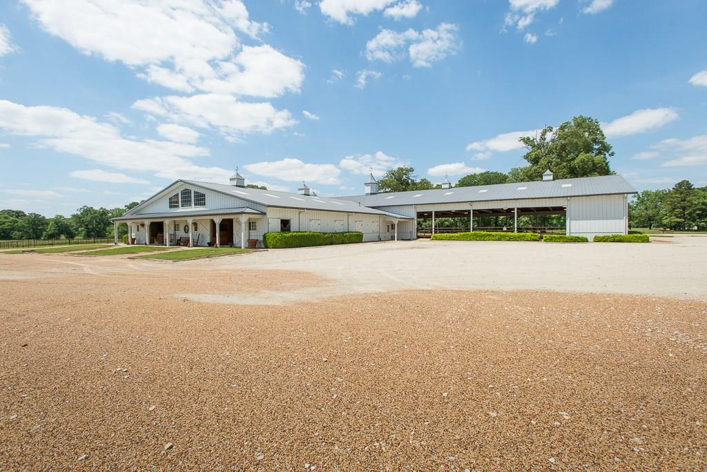 Fabulous 101 acres on this special ranch property only 1+ hours from Dallas. You'll feel a world away on this amazing equestrian estate with sandy loam soil, pipe fencing, and a 16-stall Morton-barn, 185 x 90 covered riding arena. The showcase barn features a tack room, office, client lounge, wash rack, and separate vet area. A charming southern home featuring3 bedrooms and 2 baths with covered front , two additional guest apartments offering additional 4 bedrooms and 2 more baths. Atrue family compound with  plenty of options for hosting guests. Two 1500 SF storage buildings and hay barn, complete the ideal equestrian set-up.