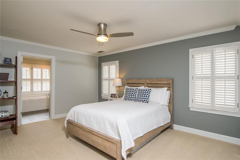 Very spacious upstairs bedroom with plantation shutters & tons of natural light! Could be used as a 2nd master suite!