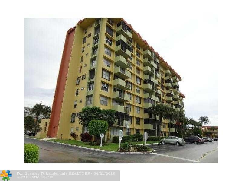 2 Bedroom, 1 1/2 Bath Penthouse Condo in Resort Style Community of the Island Club on Federal Highway between Cypress Creek Blvd & Atlantic Blvd. BREATHTAKING VIEWS of WATER from EVERY window! 24 hour manned security plus keyed door entry! 2 swimming pools, hot tub, fitness center, bbq, party room, immaculately manicured tropical grounds. Rent includes water & basic cable. Tenant occupied until May 14 but easy to show with notice.  All info deemed accurate but not guaranteed.