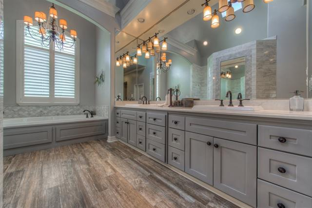 3 sides mirror from counter to ceiling gives this master bath a stunning finish.