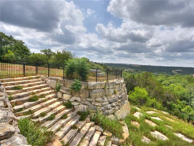 Spectacular views of the TX Hill Country! Luxury home is nestled on 5.07 acres on a cul de sac & is move-in ready with fresh paint/carpet. Much of the acreage is a natural area that doesn't require maintenance. Grand style living is captured in the floor to ceiling stone fireplace, & a large floor plan offers a Chef's kitchen, Great Room, Formal Dining, Study, Game Room and storage. Stone exterior, balcony & covered patio enhance the beauty of this custom home. Easy commute to Austin on CapMetro train.