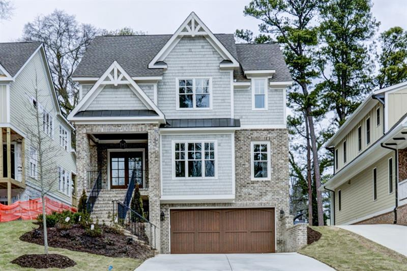 Gorgeous NEW CONSTRUCTION in Brookhaven! Open floor plan, hardwood floors, and upgraded trim on main. Chef's kitchen features custom cabinetry, high-end stainless steel appliances, quartz counters, walk-in pantry, breakfast nook, oversized island, and butler's pantry with wine fridge. Spacious family room boasts built-in storage and fireplace. Open concept dining room perfect for entertaining. Main level bedroom plus separate home management station. Master suite is a true retreat including a trey ceiling, sitting room, and private covered porch. Luxurious master bath offers two walk-in closets. Additional bedrooms each with attached baths. Laundry up! Unfinished basement waiting for your ideas. Wonderful covered patio and flat backyard ideal for outdoor enjoyment. Perfect location only minutes to your favorite Brookhaven hotspots!