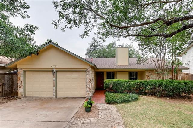 Large, beautiful trees drape this 4/2 home.  The kitchen, bathrooms and flooring have all been updated. Enjoy the shade of the back yard, or relax by the limestone fireplace in the living room.  The home has a well structured mother in law plan.  The large master suite has a separate office area for working at home.  Come visit soon!
